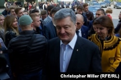 Incumbent President Petro Poroshenko speaks to RFE/RL as he arrives at Kyiv's House of Officers to cast his ballot with his wife, Maryna Poroshenko, on April 21.