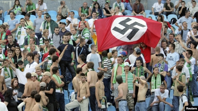 Karpaty Lviv supporters hold up a German Nazi flag at a soccer match against Dynamo Kyiv in 2007.
