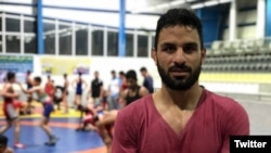 Iran -- Navid Afkari, Iranian wrestler has been reportedly sentenced to death for participating in anti-government protests in Shiraz and Kazerun, Iran.