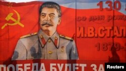 A poster with a portrait of Soviet dictator Josef Stalin is seen during a May Day rally in Volgograd. (file photo)