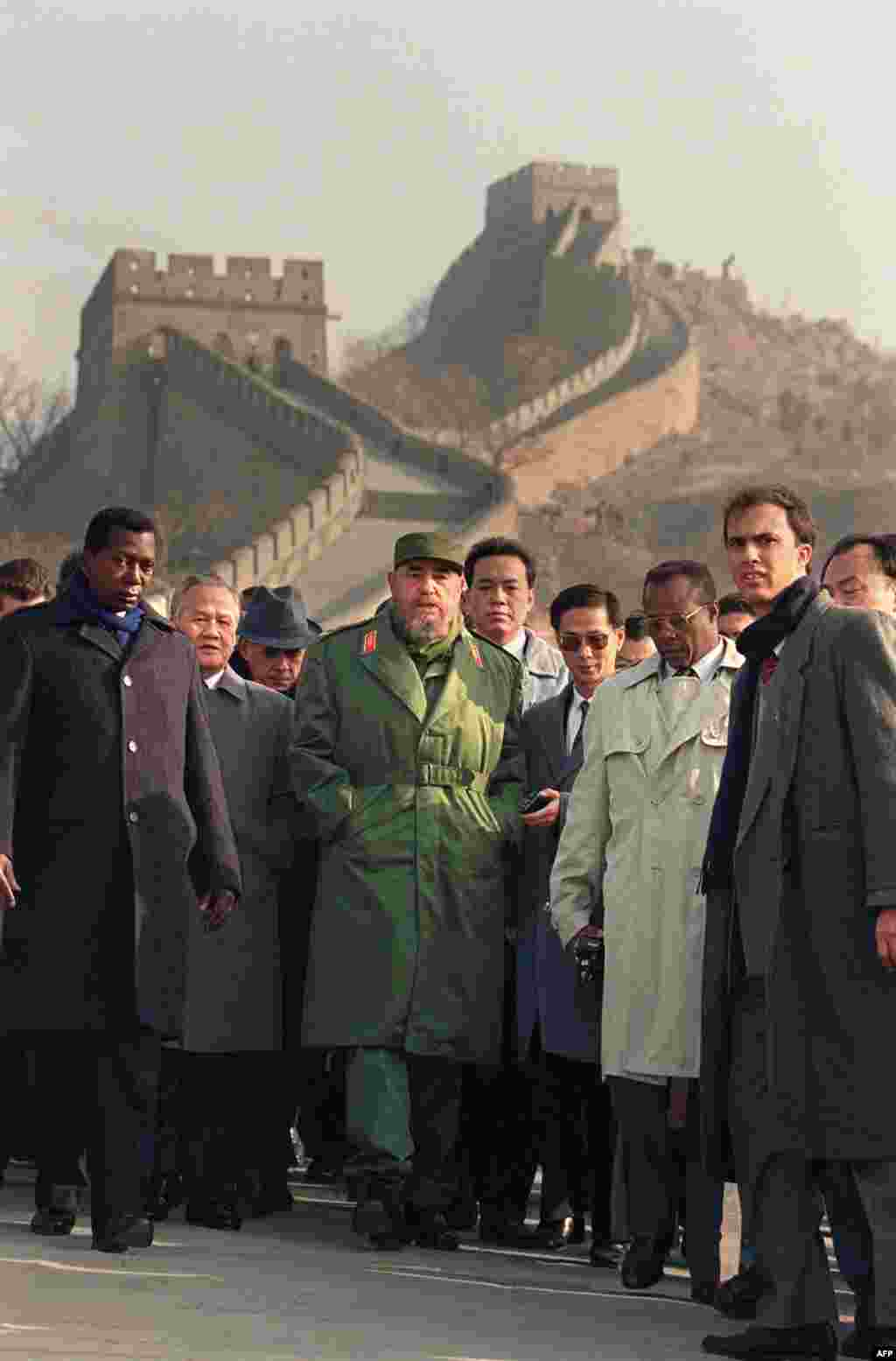 Fidel Castro (center) with guides and security agents at the Great Wall of China while on a state visit in December 1995.