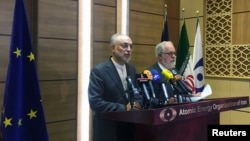 Iran's nuclear chief Ali Akbar Salehi (left) speaks during a joint press conference with European Commissioner for Energy and Climate Miguel Arias Canete in Tehran on May 19.