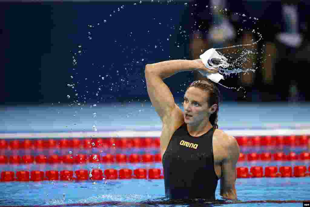 Katinka Hosszu celebrates shattering the world record in the women's 400-meter individual medley. Her winning time of 4 minutes, 26.36 seconds knocked two seconds off the previous record.