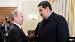 Russian President Vladimir Putin (left) welcomes Venezuelan President Nicolas Maduro during their meeting in Moscow on January 15