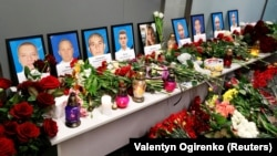 Relatives of the flight crew members of the Ukraine International Airlines plane that crashed in Iran, mourn at a memorial at Kyiv, January 8, 2020