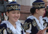 Kyrgyz women in traditional costume at a festival in Bishkek in May (RFE/RL)