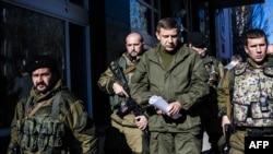 Separatist gunmen guard Aleksander Zakharchenko (center), prime minister of the self-proclaimed Donetsk People's Republic in Donetsk.