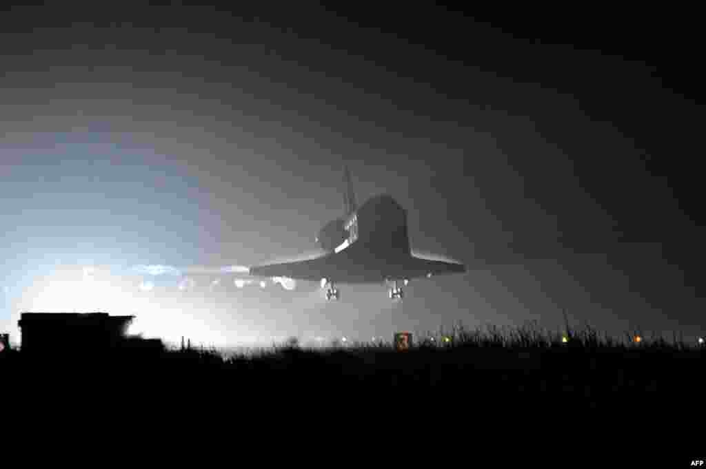 U.S. space shuttle Endeavour lands at the Kennedy Space Center in Florida after completing its final mission on June 1.Photo by Bruce Weaver for AFP.