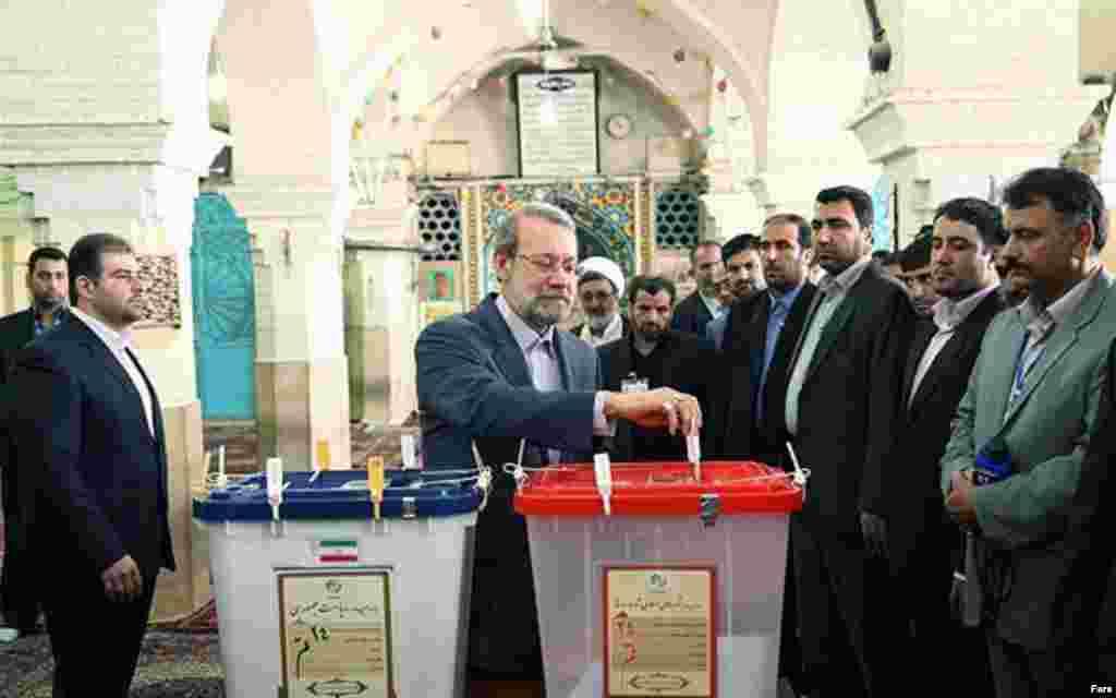 Ali Larijani casts his ballot in Tehran.