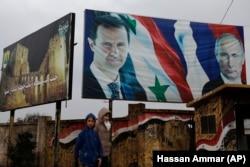 Биллборд на улице в Восточном Алеппо. 20 января