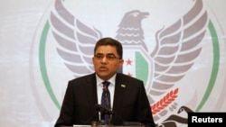 Гасан Гітто на прес-конференції у Стамбулі, 19 березня 2013 року