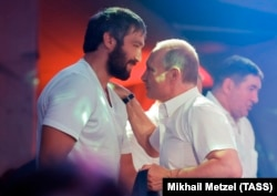 Russian ice hockey player Aleksandr Ovechkin (left) and Russian President Vladimir Putin enjoy a close relationship. They're seen here attending a combat sambo tournament in Sochi in August 2017.
