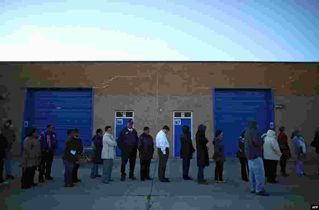 People wait in line to vote at Caroline High School in Milford, Virginia.