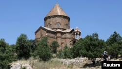 Turkey/Armenia - The Church of the Holy Cross, an Armenian church on Akhtamar Island in Lake Van, is seen near the eastern Turkish city of Van, 27Jun2010