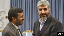 خالد مشعل، از سران حماس در سوریه، در دیدار با محمود احمدی نژاد، رییس جمهور اسلامی ایران.