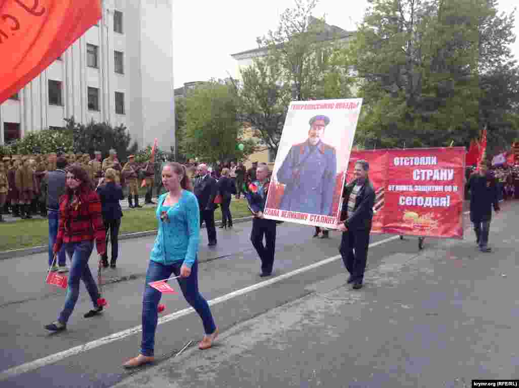 People carry a portrait of Stalin during a parade in Simferopol, Crimea.