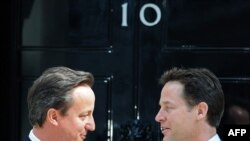 New Prime Minister David Cameron (left), a Conservative, speaks with new Deputy Prime Minister Nick Clegg, leader of the Liberal Democrats, outside 10 Downing Street in London on May 12.