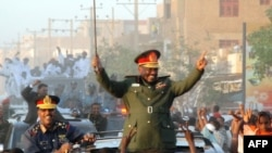Sudanese President Omar al-Bashir parades in the streets of Khartoum in March 2009.