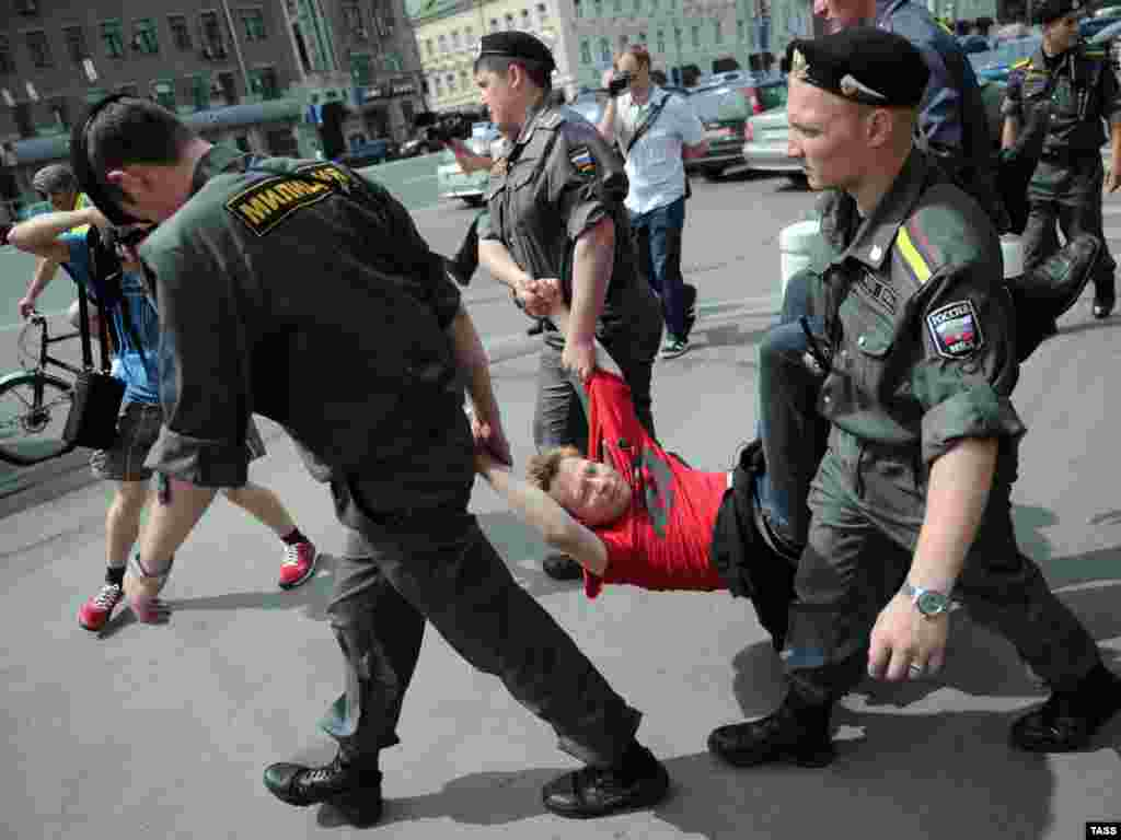 Police detain a Khodorkovsky supporter during a gathering in central Moscow in June 2011.