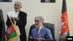 Afghan President Ashraf Ghani (left) and Chief Executive Officer Abdullah Abdullah (file photo)