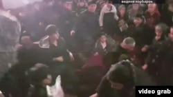 A video recording by a witness shows a group of mostly young men throwing punches at each other, and grabbing and pulling each other's jackets.