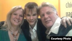 Russian teenager Maksim Kargapoltsev (center) with Mil (right) and Diana Wallen, the U.S. couple who want to adopt him.