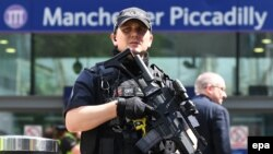 Armed police officers patrol in central Manchester on May 23.