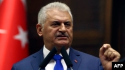 Turkey - Turkish Prime Minister and the leader of Turkey's ruling party, the Justice and Development Party (AK Party) Binali Yildirim delivers a speach during an AK Party's group meeting at the Grand National Assembly of Turkey (TBMM) in Ankara, on Octobe