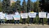 Участника санкционированного властями митинга 13 сентября в Алматы.