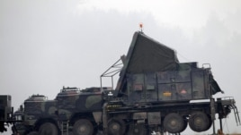 German military vehicles carrying equipment for NATO Patriot missiles at a military base in Kahramanmaras, Turkey