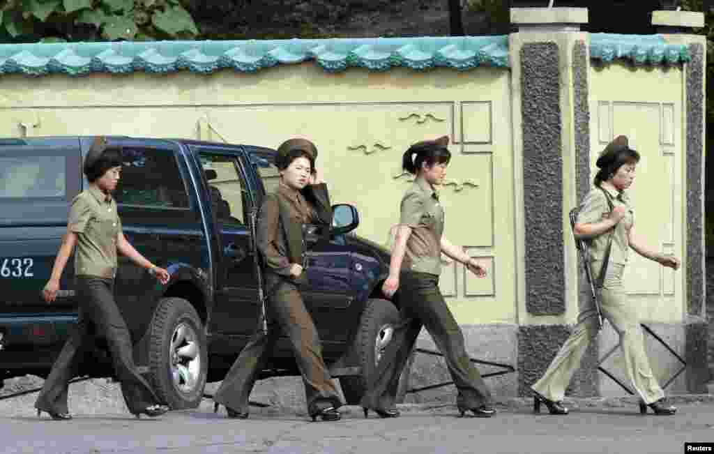 Female North Korean soldiers walk along the banks of the Yalu River near the North Korean town of Sinuiju, opposite the Chinese border city of Dandong on June 23. (Reuters/Jacky Cheng)