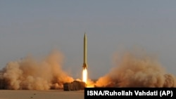 In this photo released by the semi-official Iranian Students News Agency (ISNA), an Iran's Shahab-3 missile is launched during military maneuvers outside the city of Qom, Iran, Tuesday, June 28, 2011.