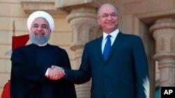 Хасан Роухани менен Бахрам Салих.