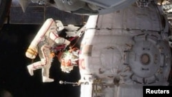 Russian cosmonaut Oleg Kononenko conducts a space walk outside the ISS on December 11.
