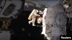 Кононенко у відкритому космосі, грудень 2018 року