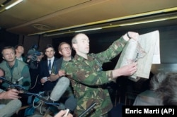 Dutch UN spokesman Major Rob Annink shows a map to journalists at the Holiday Inn in April 1994. He's pointing out the position where a British Sea Harrier jet was shot down over the besieged Bosnian enclave of Gorazde.