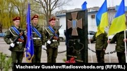 An opening ceremony for a memorial in honor of National Guard soldiers in Kherson on March 26
