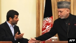 Iran President Mahmud Ahmadinejad (left) with his Afghan counterpart, Hamid Karzai, in Kabul on March 10
