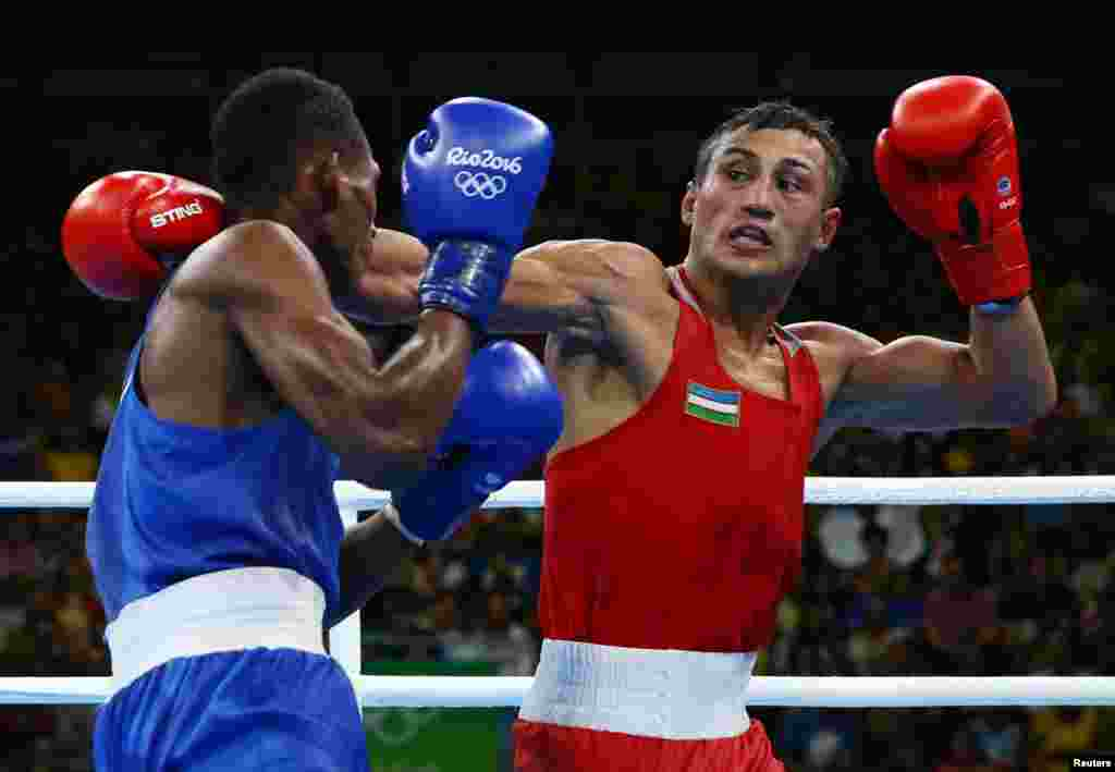 Fazliddin Gaibnazarov of Uzbekistan (in red) defeated Cuban-born Lorenzo Sotomayor Collazo, representing Azerbaijan, in the light welterweight final. Russia's Vitaly Dunaytsev won bronze.