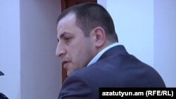 Armenia - Mihran Keshishian, police officer, allegedly assaulted by opposition activist Samson Khachatrian, attends his trial, 19Apr2011.