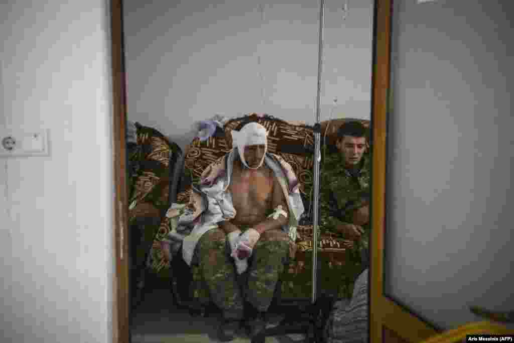 A wounded soldier receives treatment in the basement of a medical center outside the city of Stepanakert on October 14 during ongoing fighting between Armenia and Azerbaijan over the breakaway region. (AFP/Aris Messinis)