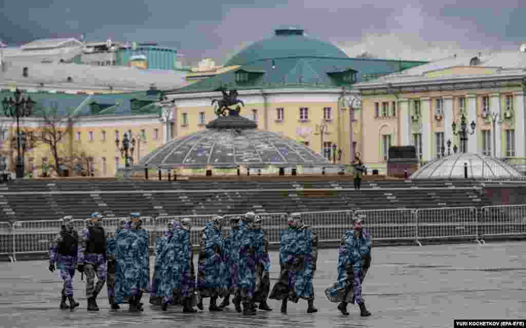 Russian policemen walk on Manezhnaya Square in preparation for a possible opposition rally and prevention of riots in Moscow, April 21, 2021.