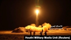 A photo distributed by the Houthi Military Media Unit shows the launch by Houthi forces of a ballistic missile aimed at Saudi Arabia, March 25, 2018
