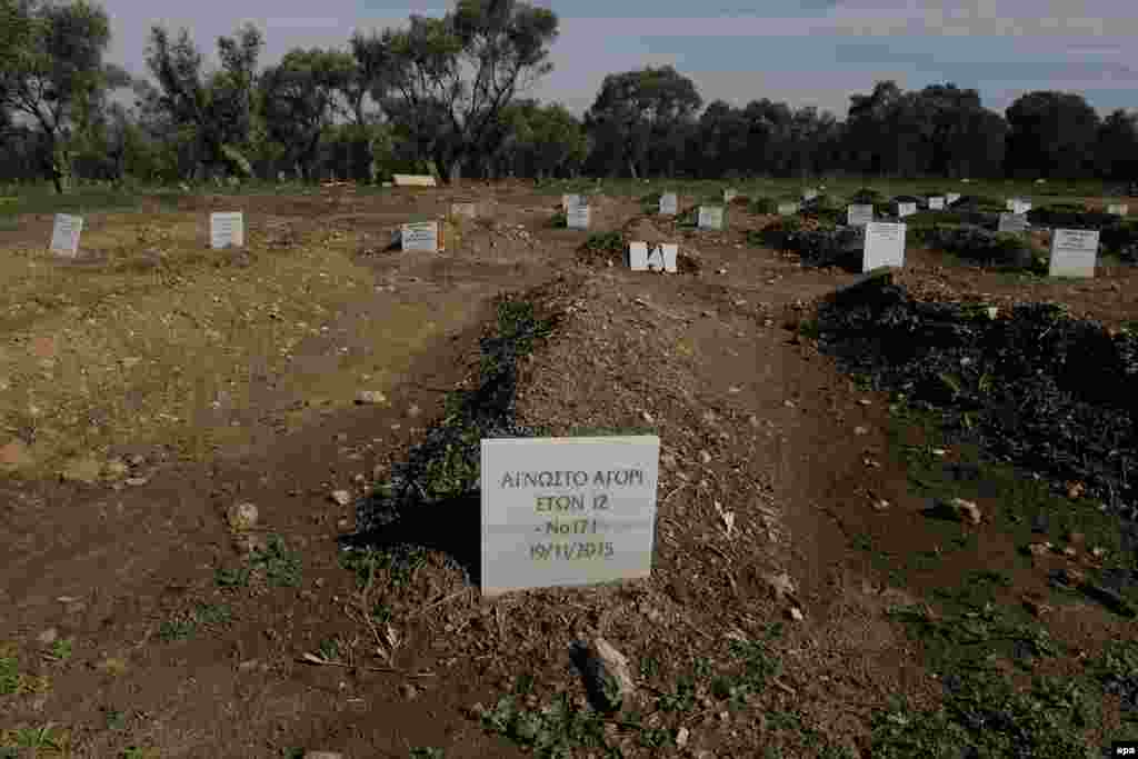 The grave of an unidentified 12-year-old boy who drowned as he was trying to cross the channel between the Turkish coastline and the Greek island of Lesbos, at a cemetery for refugees or migrants, near the original cemetery of Kato Tritos, on Lesbos Island, Greece. (epa/Orestis Panagiotou)
