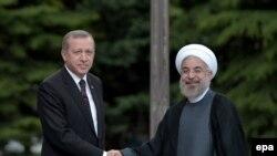 Recep Tayyip Erdogan İran prezidenti Hassan Rohani ilə, iyun, 2014-cü il