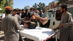 An Afghan man who was injured in a bomb blast is shifted to a hospital in Lashkar Gah, the capital of Helmand Province.