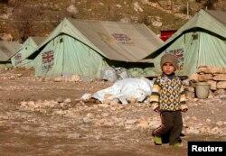 Мальчик из семьи беженцев-езидов из Ирака в лагере беженцев. Шихан, 19 января 2015 года.