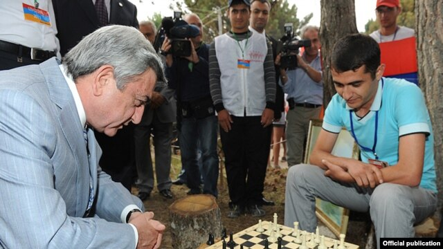 Armenian President Serzh Sarkisian plays chess during a visit to a youth camp in Lake Sevan in August.