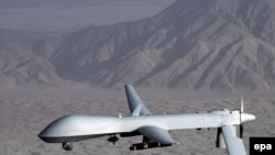 A MQ-1 Predator drone aircraft in flight at an undiclosed location.