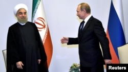 Russian President Vladimir Putin (right) and Iranian leader Hassan Rohani during a 2016 meeting in Baku